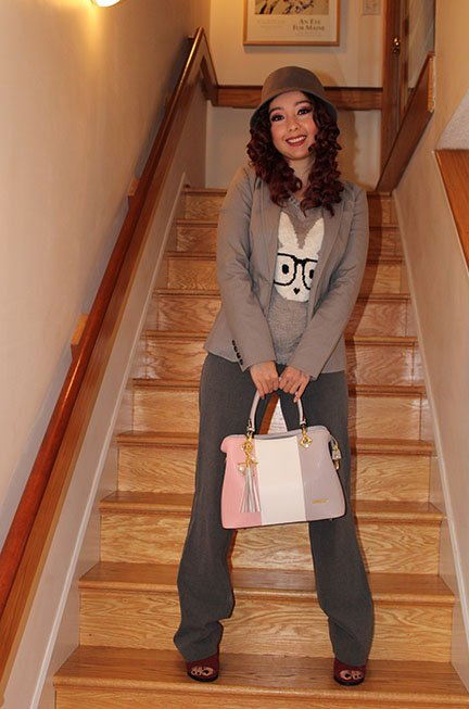 geeves holding a purse while standing on stairs