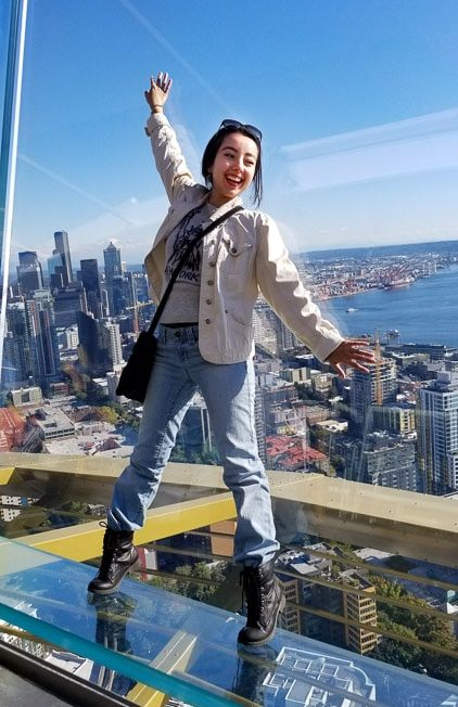 Geeves at the top of the space needle with a view of seattle