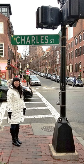 Geeves wearing a winter coat on St. Charles Street in Boston